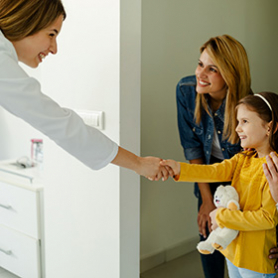 check out staff handing information to a patient's parent